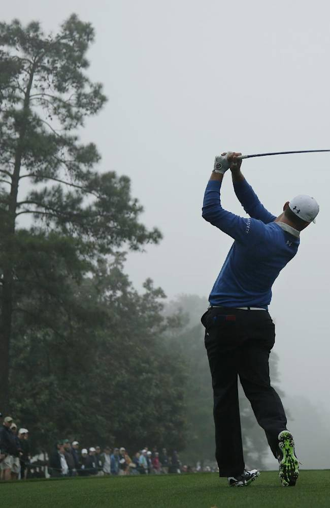 Gary Woodland tees off on the ninth hole during a practice session for the Masters golf tournament Monday, April 7, 2014, in Augusta, Ga