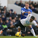 Tottenham's Danny Rose, falls to the ground after being fouled by Everton's Gerard Deulofeu during the English Premier League soccer match between Tottenham Hotspur and Everton at the White Hart Lane stadium in London, Sunday, Feb. 9 2014