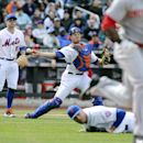 New York Mets catcher Travis d'Arnaud, center, throws out Cincinnati Reds left fielder Roger Bernadina as New York Mets starting pitcher Dillon Gee (35) and third baseman David Wright (5) look on in the seventh inning of a baseball game at Citi Field, Sa