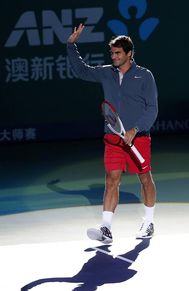 Roger Federer of Switzerland waves to his fans during the fan meeting event ahead of the Shanghai Rolex Masters at Qizhon Tennis Center in Shanghai, China, Saturday, Oct. 5, 2013