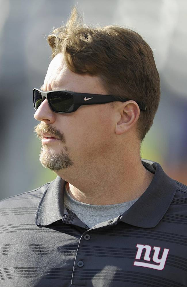 This is an Aug. 9, 2014, file photo showing New York Giants offensive coordinator Ben McAdoo watching the teams warm up before an NFL football game between the Giants and the Pittsburgh Steelers in East Rutherford, N.J.  Two games into the preseason schedule, the Giants offense is still looking got answers under  McAdoo