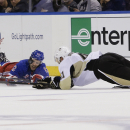 New York Rangers' Lee Stempniak (12) and Pittsburgh Penguins' Robert Bortuzzo (41) dive for the puck during the second period of an NHL hockey game Tuesday, Nov. 11, 2014, in New York The Associated Press