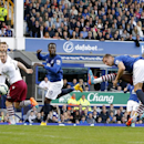 Everton's Phil Jagielka, second right, scores his side's first goal of the game during their English Premier League soccer match against Aston Villa at Goodison Park, Liverpool, England, Saturday, Oct. 18, 2014