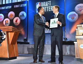 NEW YORK - MAY 19: NBA Deputy Commissioner Mark Tatum congrats Owner Glen Taylor of the Minnesota Timberwolves for winning the 2015 NBA Draft Lottery reception on May 19, 2015 at the New York Hilton Midtown in New York City. (Photo by Jesse D. Garrabrant/NBAE via Getty Images)