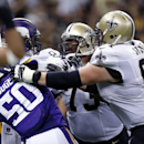 New Orleans Saints guard Jahri Evans (73) gets into a scuffle with Minnesota Vikings outside linebacker Gerald Hodges (50) after a roughing the passer call in the second half of an NFL football game in New Orleans, Sunday, Sept. 21, 2014 The Associated Pr