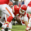 Kansas City Chiefs quarterback Alex Smith (11) fumbles as he is tackled by Cincinnati Bengals defensive end Robert Geathers in the first half of an NFL preseason football game Thursday, Aug. 7, 2014, in Kansas City, Mo. The Bengals recovered the ball The