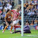 Stoke City's Ryan Shawcross, centre, scores his teams first goal against Hull City, during their English Premier League match at the KC Stadium, Hull, England, Sunday Aug, 24, 2014