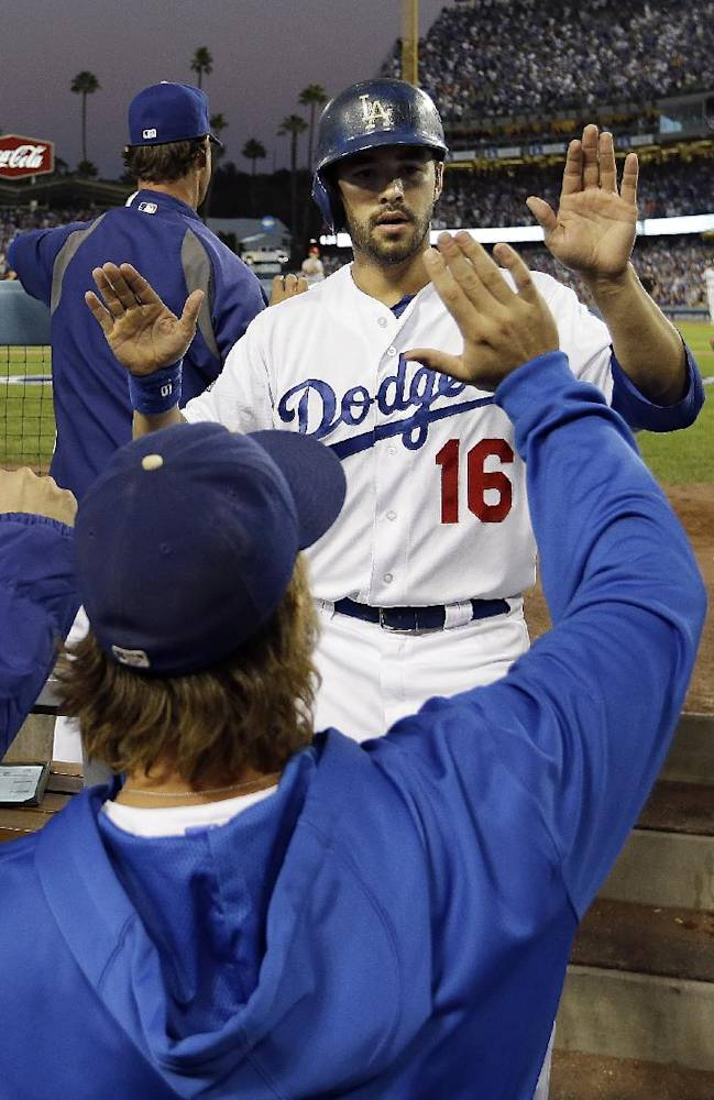 Los Angeles Dodgers' Andre Ethier is congratulated in the dugout after scoring during the fourth inning of Game 4 of the National League baseball championship series against the St. Louis Cardinals, Tuesday, Oct. 15, 2013, in Los Angeles