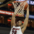 Louisville's Wayne Blackshear goes up for a dunk during their NCAA college basketball scrimmage Saturday, Oct. 5, 2013, in Louisville, Ky. (AP Photo/Timothy D. Easley)