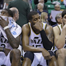 Utah Jazz's Marvin Williams, left, Derrick Favors, center, and Enes Kanter (0) sit on the bench at the end of their NBA basketball game against the Detroit Pistons Monday, March 24, 2014, in Salt Lake City. The Pistons won 114-94 The Associated Press