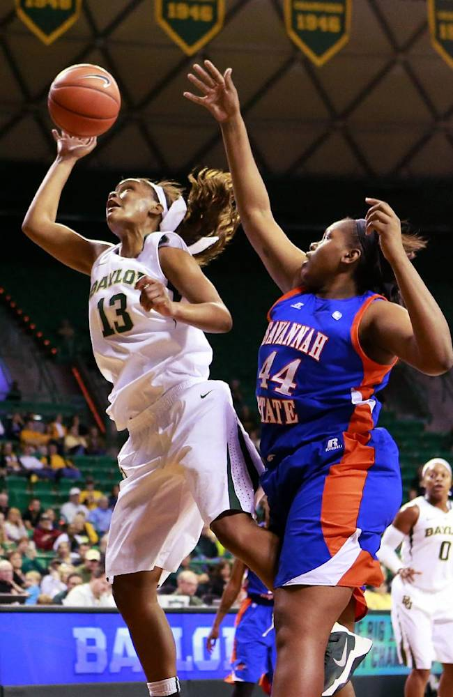 Savannah State center Tiyonda Davis (44) defends against Baylor forward Nina Davis (13)  during second half of an NCAA college basketball game, Thursday, Nov. 21, 2013, in Waco, Texas.   Baylor won 99-31