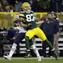 Chicago Bears cornerback Tim Jennings (26) breaks up a pass intended for Green Bay Packers wide receiver Jordy Nelson (87) during the first half of an NFL football game Sunday, Nov. 9, 2014, in Green Bay, Wis. Jennings was called for a pass interference o