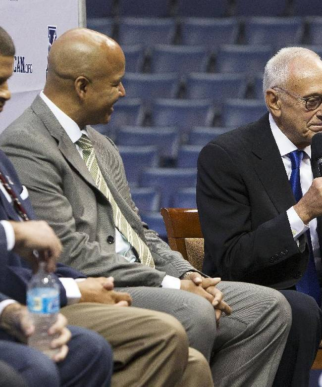 SMU head coach Larry Brown, right, answers questions at the American Athletic Conference NCAA college basketball media day on Wednesday, Oct. 16, 2013, in Memphis, Tenn