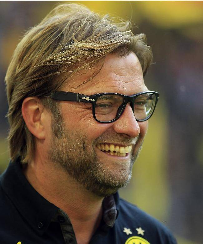Dortmund head coach Juergen Klopp smiles prior to the German first division Bundesliga soccer match between BvB Borussia Dortmund  and SC Freiburg in Dortmund, Germany, Saturday, Sept. 28, 2013