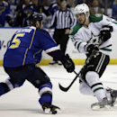 Dallas Stars' Tyler Seguin, right, passes around St. Louis Blues' Barret Jackman during the first period of an NHL hockey game Tuesday, March 11, 2014, in St. Louis The Associated Press