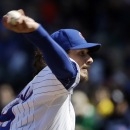 Chicago Cubs starter Jeff Samardzija throws against the Philadelphia Phillies during the third inning of a baseball game in Chicago, Saturday, April 5, 2014 The Associated Press