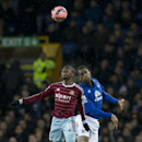 Everton's Sylvain Distin, left, in action against West Ham United's Enner Valencia during their English FA Cup third round soccer match at Goodison Park Stadium, Liverpool, England, Tuesday Jan. 6, 2015