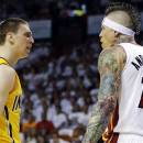 Indiana Pacers forward Tyler Hansbrough (50) exchanges words with Miami Heat forward Chris Andersen (11) during the first half of Game 1 in their NBA basketball Eastern Conference finals playoff series, Wednesday, May 22, 2013 in Miami. Andersen was charged with a technical foul. (AP Photo/Lynne Sladky)