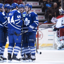 Toronto Maple Leafs' Morgan Rielly (44) celebrates with teammates Leo Komarov (47) Nazem Kadri (43) Mike Santorelli (25) Stephane Robidas (12) in front of Washington Capitals goaltender Justin Peters after scoring a goal during the first period of an NHL