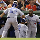 Toronto Blue Jays' Melky Cabrera (53) is congratulated by teammate Jose Reyes after his second two run, home run of the game against the Boston Red Sox during the sixth inning of a baseball game at Fenway Park in Boston, Monday, July 28, 2014. (AP Photo/Charles Krupa)