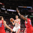 HOUSTON, TX - MARCH 30: Jeremy Lin #7 of the Houston Rockets shoots the ball against the Los Angeles Clippers on March 30, 2013 at the Toyota Center in Houston, Texas. (Photo by Bill Baptist/NBAE via Getty Images)