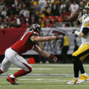 Atlanta Falcons outside linebacker Kroy Biermann (71) chases Pittsburgh Steelers quarterback Ben Roethlisberger (7) during the first half of an NFL football game, Sunday, Dec. 14, 2014, in Atlanta The Associated Press