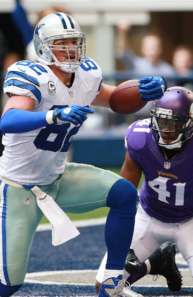 Dallas Cowboys tight end Jason Witten (82) celebrates his touchdown in front of Minnesota Vikings strong safety Mistral Raymond (41) during the second half of an NFL football game Sunday, Nov. 3, 2013, in Arlington, Texas