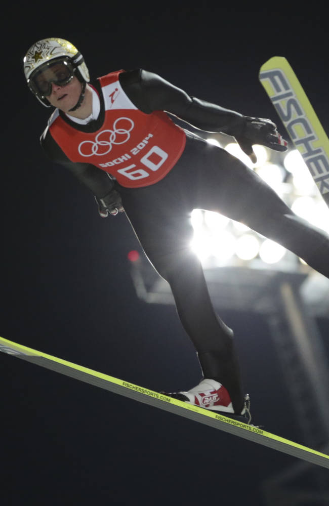 Austria's Thomas  Morgenstern makes an attempt in the men's normal hill ski jumping training at the 2014 Winter Olympics, Thursday, Feb. 6, 2014, in Krasnaya Polyana, Russia