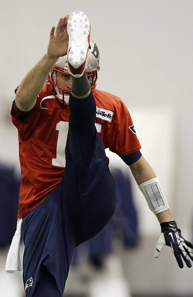 New England Patriots quarterback Tom Brady (12) loosens up during a stretching session before NFL football practice at the team's facility in Foxborough, Mass., Tuesday, Jan. 7, 2014. The Patriots are scheduled to host the Indianapolis Colts in an NFL football divisional playoff game on Saturday, Jan. 11