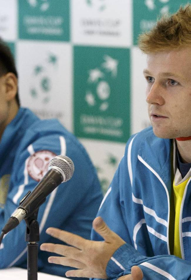 Andrey Golubev, left, of Kazakhstan, sitting next to Kazakhstan's Davis Cup Team captain Dias  Doskarayev, right, speaks to the media during a press conference of the Kazakhstan's Davis Cup  tennis team prior to the Davis Cup World Group quarterfinal match between Switzerland and Kazakhstan,  in Geneva, Switzerland, Tuesday, April 1, 2014
