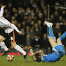 Sunderland's Steven Fletcher, right, falls as he competes for the ball with Fulham's Nikolay Bodurov during the English FA Cup fourth round replay soccer match between Fulham and Sunderland at Craven Cottage stadium in London, Tuesday, Feb. 3, 2015