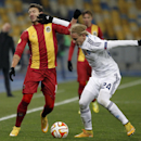 Rio Ave Ukra, left, challenges for the ball against Domagoj Vida of Dynamo Kiev during a Europa League Group J soccer match between Dynamo Kiev and Rio Ave at the Olympiyskiy national stadium in Kiev, Ukraine, Thursday, Nov. 27, 2014 The Associated Press