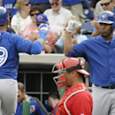 Toronto Blue Jays right fielder Jose Bautista (19) is greeted by teammate Edwin Encarnacion, right, after hitting a home run during the first inning of an exhibition baseball game against the Philadelphia Phillies Wednesday, Feb. 26, 2014, in Clearwater,