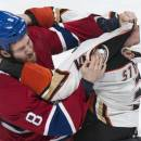 Montreal Canadiens' Brandon Prust and Anaheim Ducks' Clayton Stoner square off during the third period of an NHL hockey game, Thursday, Dec. 18, 2014, in Montreal. (AP Photo/The Canadian Press, Paul Chiasson)