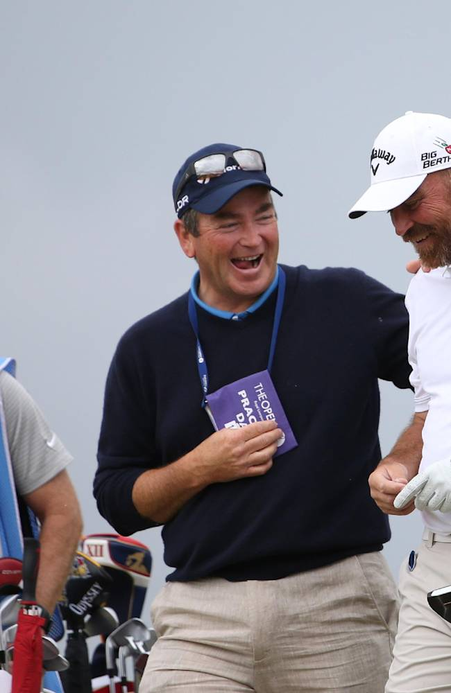 Thomas Bjorn of Denmark, right, prepares to play off the 15th tee during a practice round ahead of the British Open Golf championship at the Royal Liverpool golf club, Hoylake, England, Wednesday July 16, 2014. The British Open Golf championship starts Thursday July 17