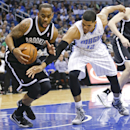 Orlando Magic's Tobias Harris (12) fouls Brooklyn Nets' Marcus Thornton, left, as he tries to knock the ball out of his hands during the first half of an NBA basketball game in Orlando, Fla., Wednesday, April 9, 2014 The Associated Press