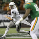 Nevada quarterback Cody Fajardo (17) tries to run past the Hawaii defense during the 4th quarter of the NCAA college football game, Saturday, Oct. 25, 2014, in Honolulu. Nevada defeated Hawaii 26-18 The Associated Press