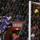 Manchester City's goal keeper Costel Pantilimon jumps and watches as the ball kicked by Southampton's Pablo Daniel Osvaldo enters the goal during the English Premier League soccer match between Southampton and Manchester City at St Mary's Stadium in Sout