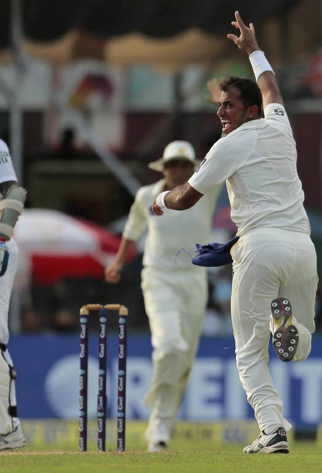 Pakistani bowler Wahab Riaz celebrates the dismissal of Sri Lanka's Angelo Mathews during the first day of the second test cricket match between Sri Lanka and Pakistan in Colombo, Sri Lanka, Thursday, Aug. 14, 2014