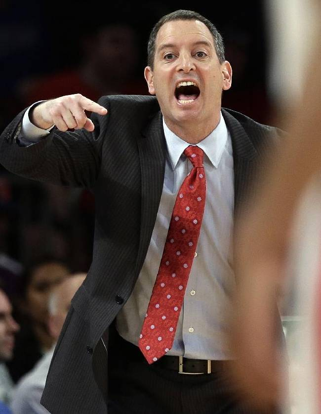 In this Tuesday, March 12, 2013 file photo, Rutgers head coach Mike Rice calls out to his team during the first half of an NCAA college basketball game against DePaul at the Big East Conference tournament, in New York. Rice was fired in early April 2013 for screaming at his players, calling them names, and kicking and shoving them