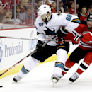 San Jose Sharks defenseman Brent Burns, left, and New Jersey Devils right wing Michael Ryder compete for the puck during the second period of an NHL hockey game, Saturday, Oct. 18, 2014, in Newark, N.J The Associated Press