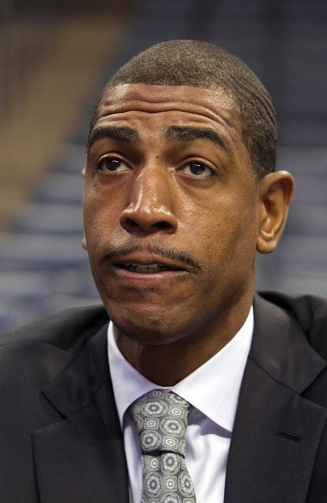 Connecitcut coach Kevin Ollie answers questions at the American Athletic Conference NCAA college basketball media day on Wednesday, Oct. 16, 2013, in Memphis, Tenn