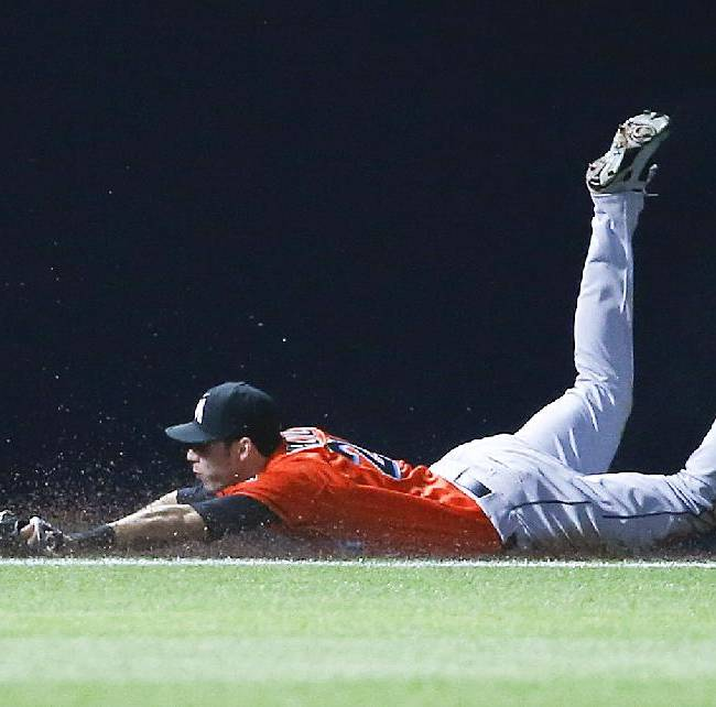 Miami Marlins left fielder Christian Yelich (21) can't reach a ball hit for a double by Atlanta Braves pinch hitter Jordan Schafer in the ninth inning of a baseball game Monday, April 21, 2014 in Atlanta.  Atlanta won 4-2 in the tens innings