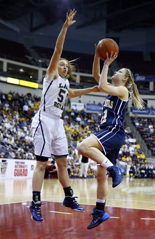 Old Forge's Lauren Carey, right, shoots as Vincent Academy's Brenna Wise defends during the first half of the PIAA Class 1A girls' basketball championship game, Saturday, March 22, 2014, in Hershey, Pa