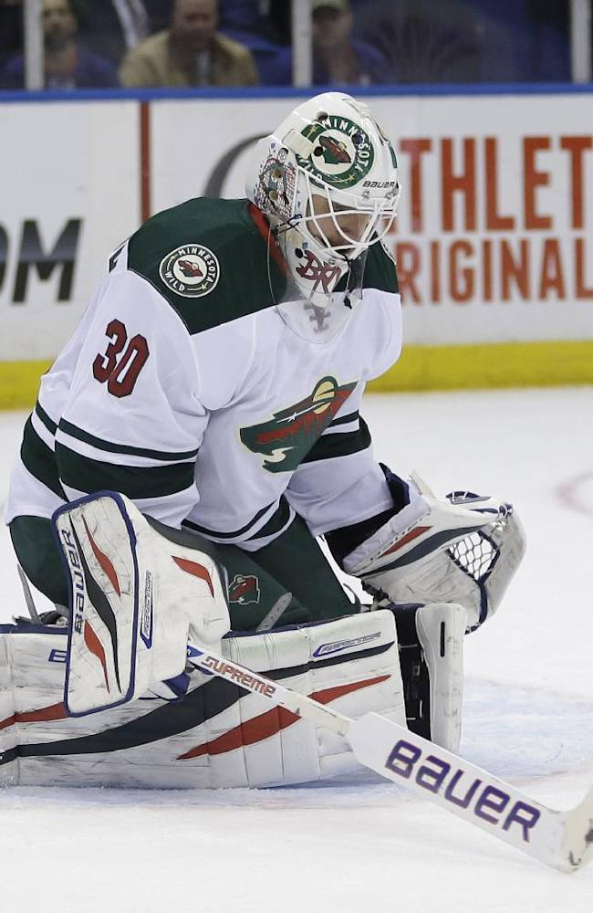 Minnesota Wild goalie Ilya Bryzgalov makes a save during the second period of the NHL hockey game against the New York Islanders, Tuesday, March 18, 2014, in Uniondale, New York