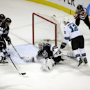 San Jose Sharks' Joe Pavelski (8) scores past Los Angeles Kings goalie Jonathan Quick, center, during the third period of an NHL hockey game Wednesday, Jan. 21, 2015, in San Jose, Calif. San Jose won 4-2 The Associated Press