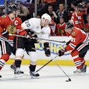 Anaheim Ducks center David Steckel, center, tries to keep the puck away from Chicago Blackhawks center Jonathan Toews, left, and right wing Marian Hossa during the second period of an NHL hockey game Friday, Dec. 6, 2013, in Chicago The Associated Press