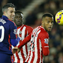 Manchester United's Robin Van Persie, left, and Southampton's Ryan Bertrand watch the ball go past during their English Premier League soccer match between Southampton and Manchester United at St Mary's stadium in Southampton, England, Monday, Dec. 8, 201