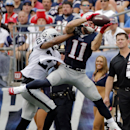 New England Patriots wide receiver Julian Edelman (11) catches a pass in front of Oakland Raiders cornerback Carlos Rogers (27) in the second half of an NFL football game Sunday, Sept. 21, 2014, in Foxborough, Mass The Associated Press