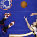 Utah Jazz's Gordon Hayward, right, goes up for a shot past a fallen Philadelphia 76ers' Thaddeus Young during the second half of an NBA basketball game, Saturday, March 8, 2014, in Philadelphia The Associated Press
